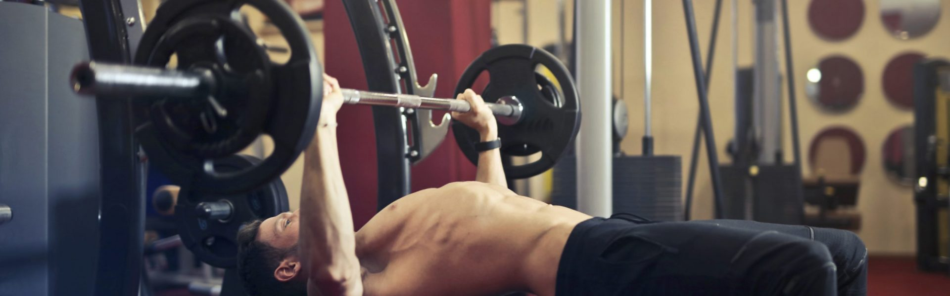 gym fitness insurance, man lifting weights on bench