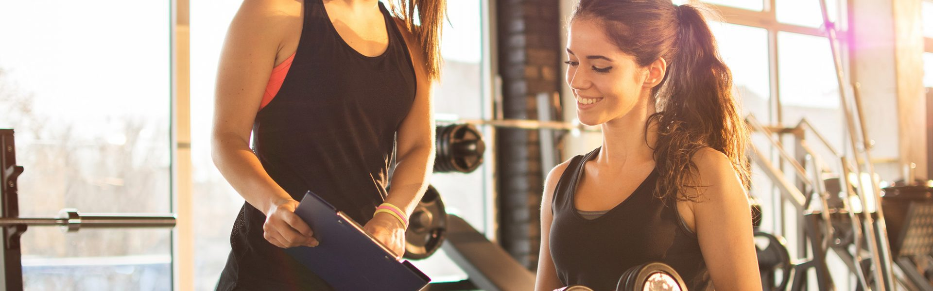 fitness instructor with client with insurance