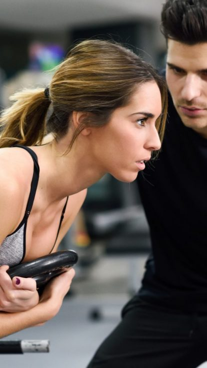 personal trainer giving advice with insurance