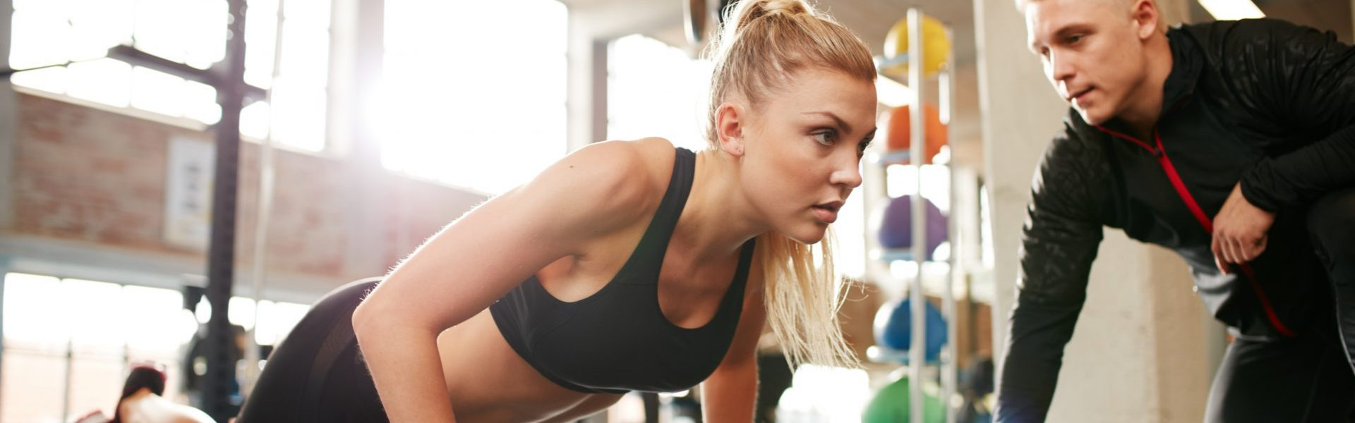 personal trainer insurance girl doing push ups with training