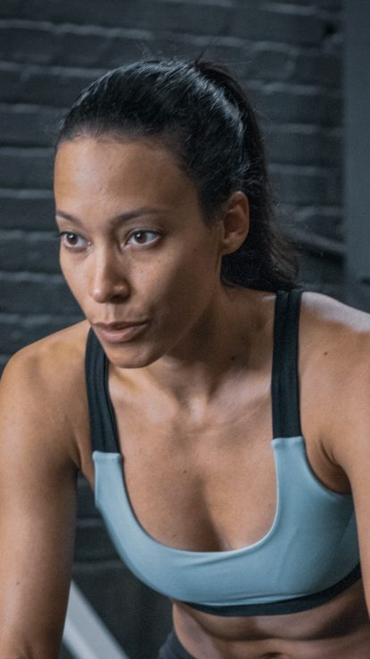 woman resting in gym, insurance for gyms